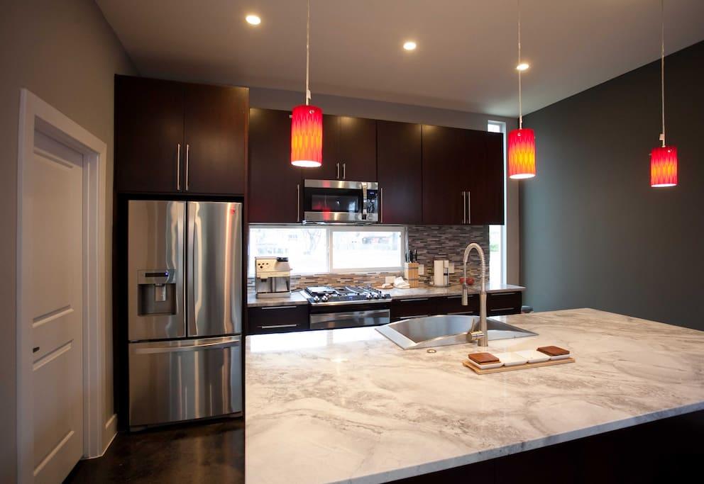 Upgraded kitchen, with gas range, dishwasher, and garbage disposal