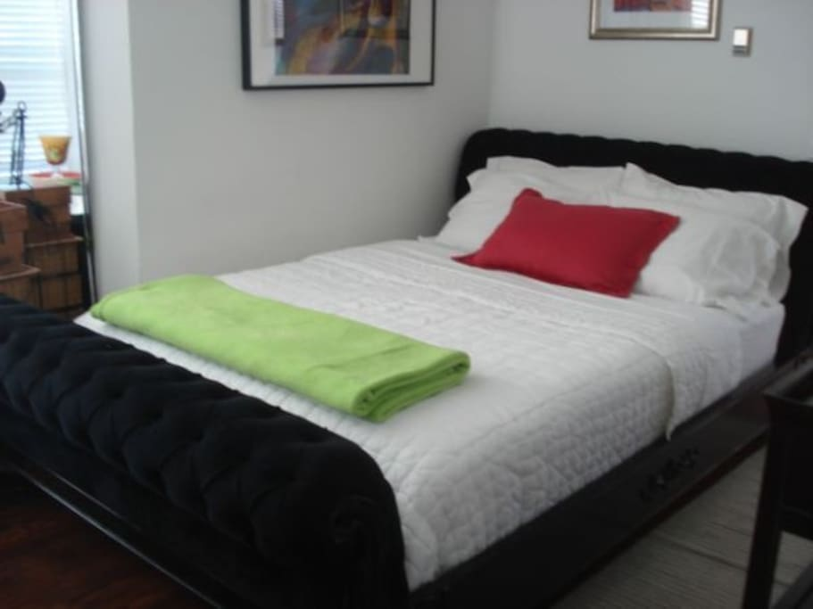 Bedroom holds beautiful valour qn bed frame, with comfortable numbers bed