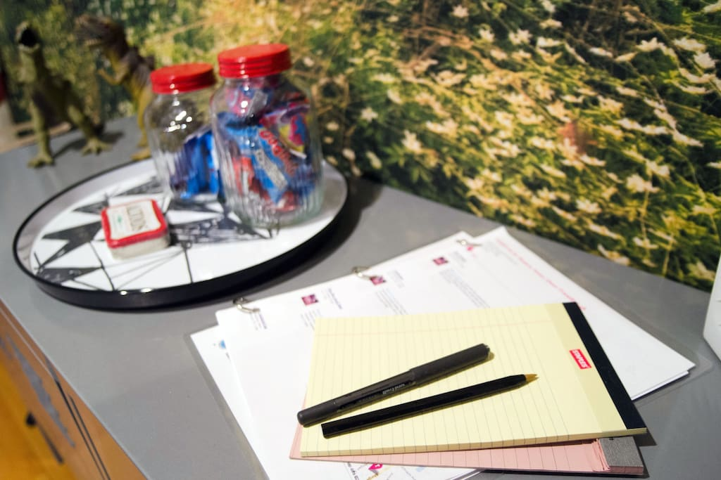 Pen, paper, and guidebook, for guests.