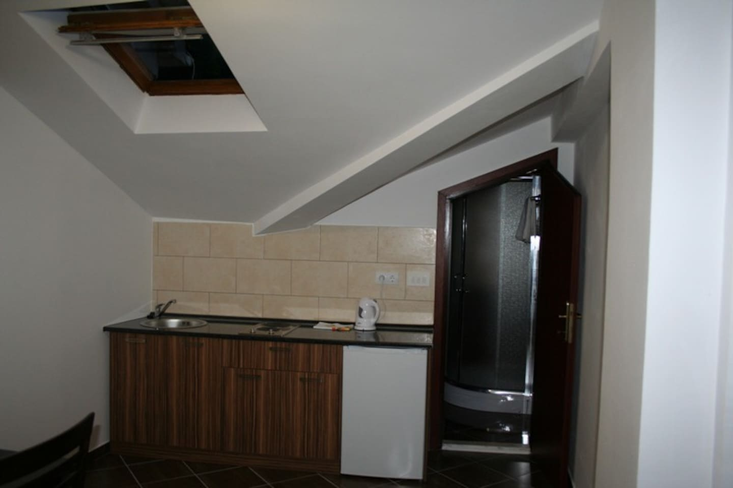 Apartment IV is one bedroom apartment for two persons, in which there is a separate kitchen with dining room and separate bathroom. Very nice for couples.