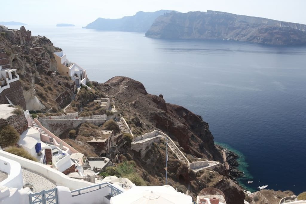The view from the balcony...Thirassia island, and the steps that lead down to Ammoudi bay.