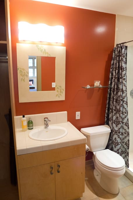 A modern and convenient bathroom with a large walk-in, tiled shower.