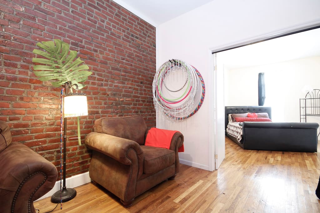 Beautiful exposed brick walls, and the entrance to your room with double opening doors.