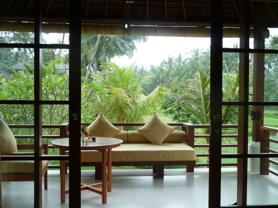 Your own private balcony where you can enjoy your rice field, pool and tropical garden view.