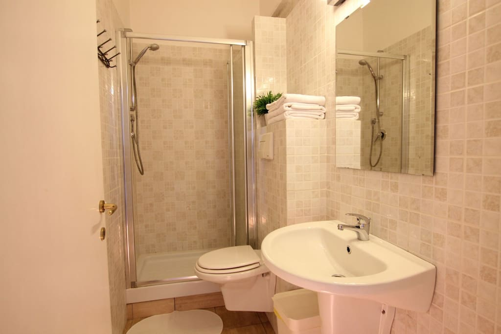 ...the bathroom with a spacious shower...