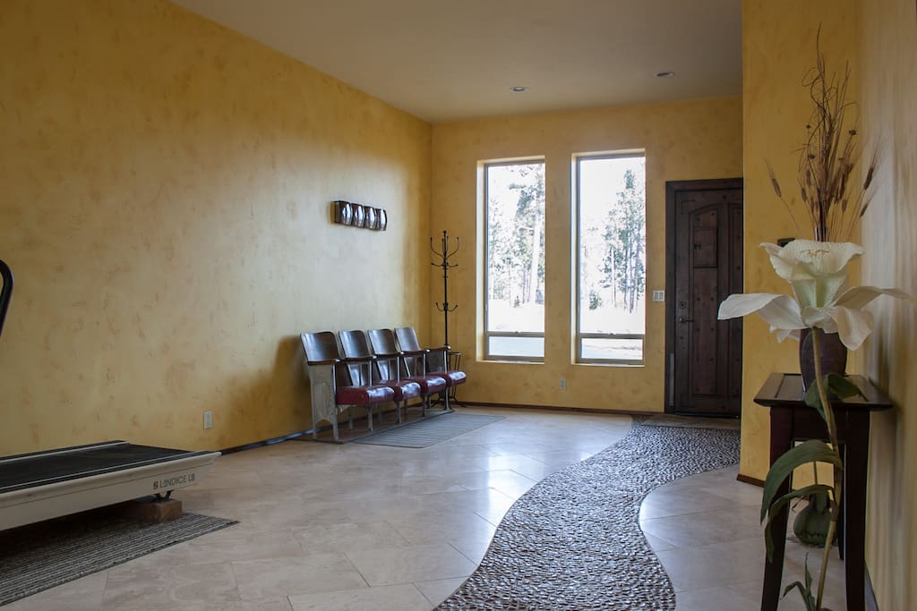 An inviting entry way guides you with a stone path toward your room.
