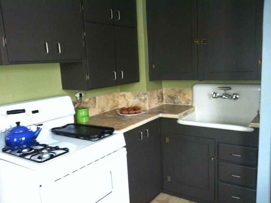 The kitchen is fully stocked with a full size fridge and dishwasher.