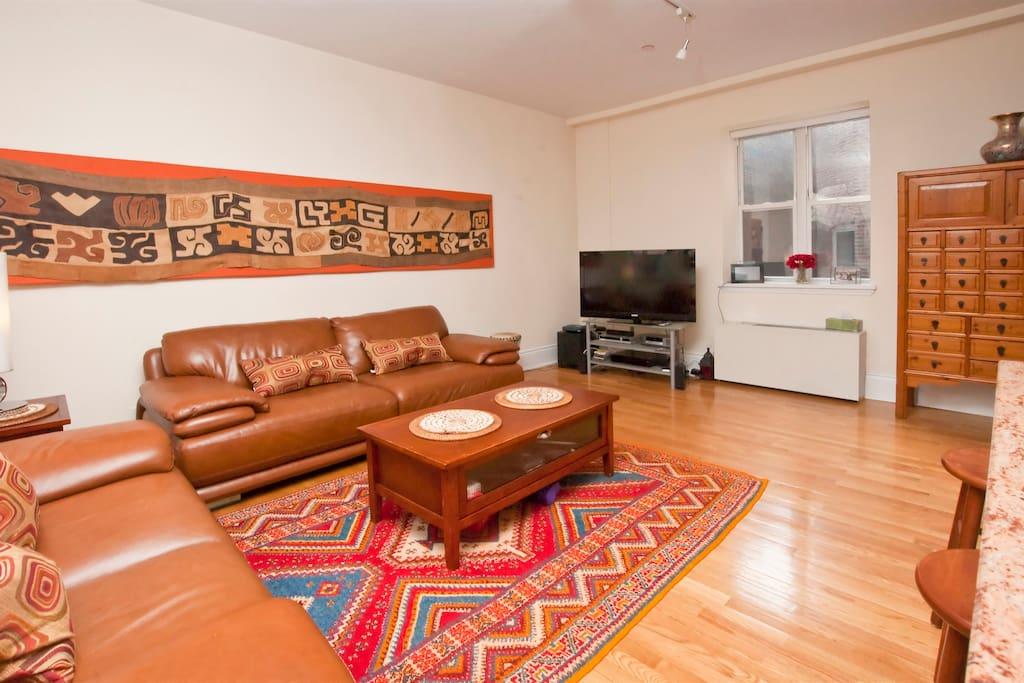 Four (4) great windows, italian sofa, Painting -S. Africa, Batik -Zambia, rug -Marocco, tamtam- Senegal
