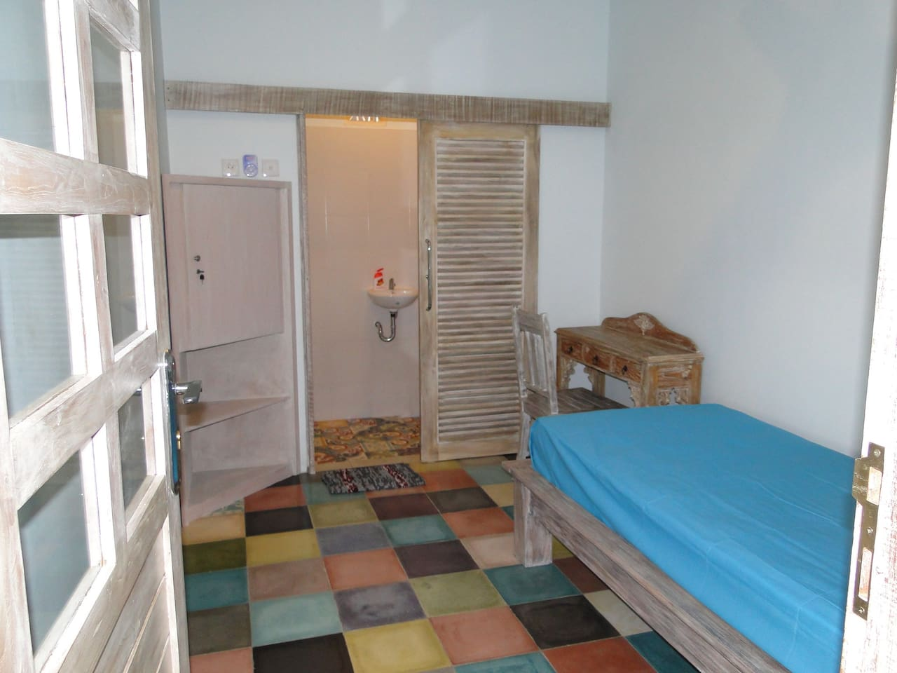 single room number #3 with lockable cabinets and table and chair and ensuite with own hot water