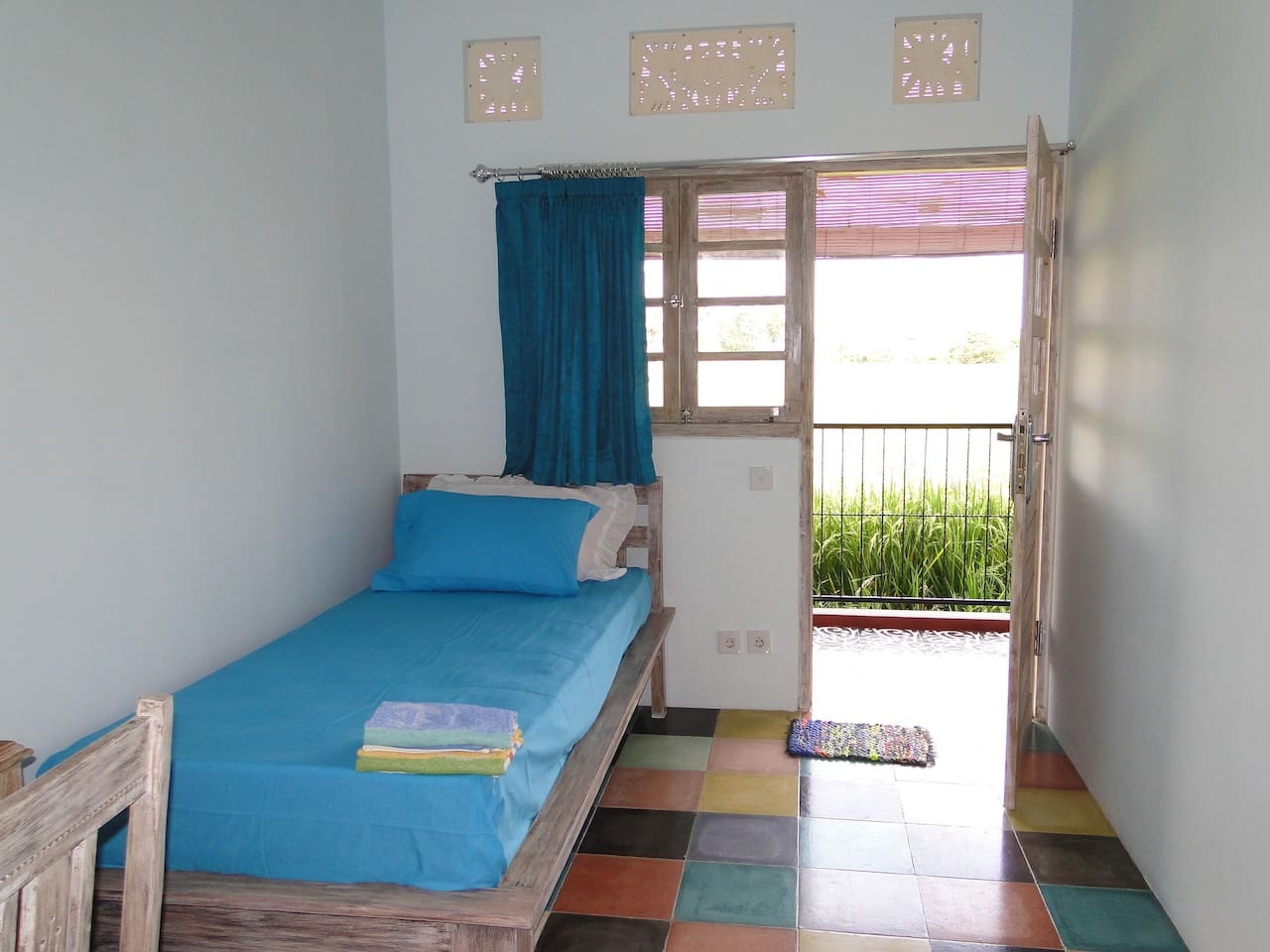 one of two single rooms available. lockable cabinet and table and chair. own ensuite