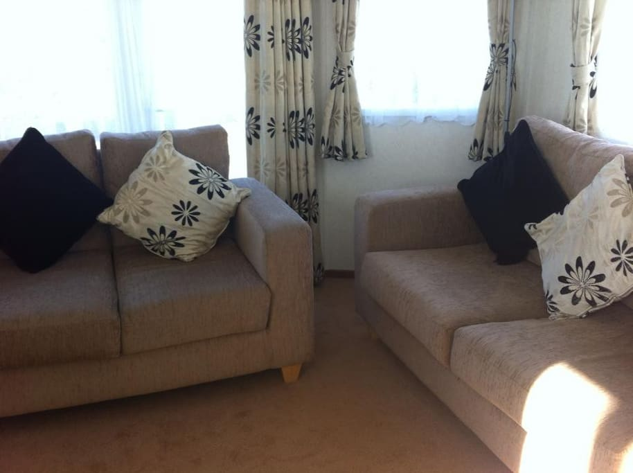 The sitting area. the sofa on the right hand side of the image pulls out to make a double bed.