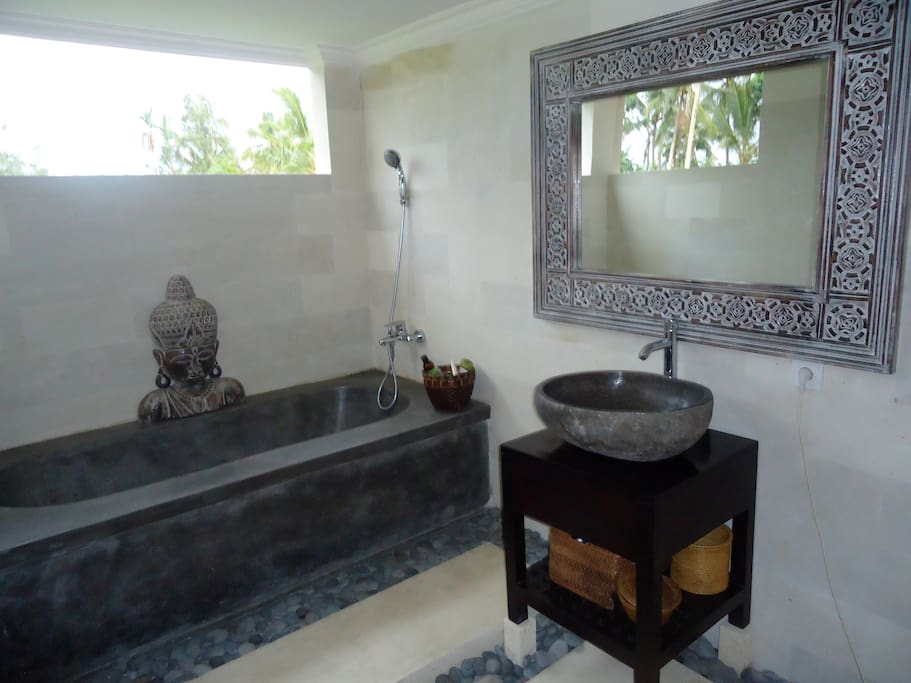 The Joglo bathroom offers the luxury of organic building materials and a view over nature