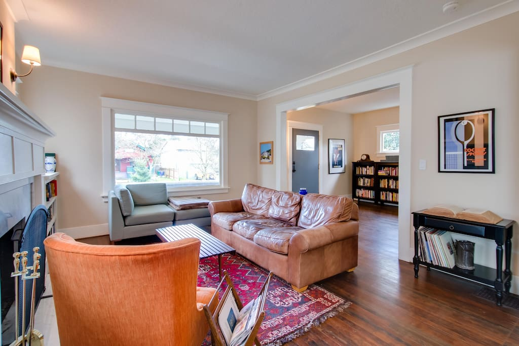 Spacious living room with marble fireplace, built-in bookshelves and tons of light!