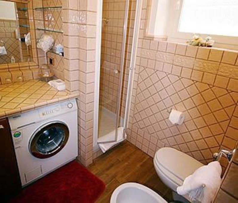 Bathroom, washing machine and shower