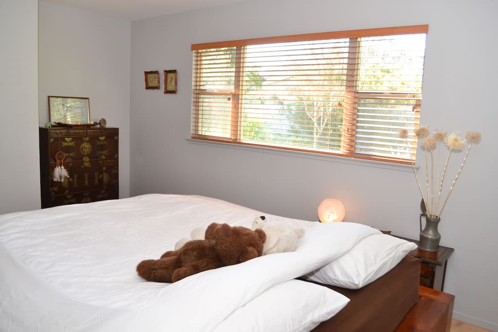 California King size bed with amazing natural light and view on garden
