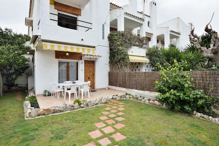 Charming beach house with a garden