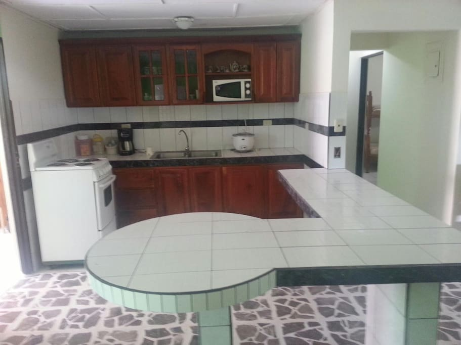 Kitchen with custom built, locally sourced wooden cabinets and seating for 10
