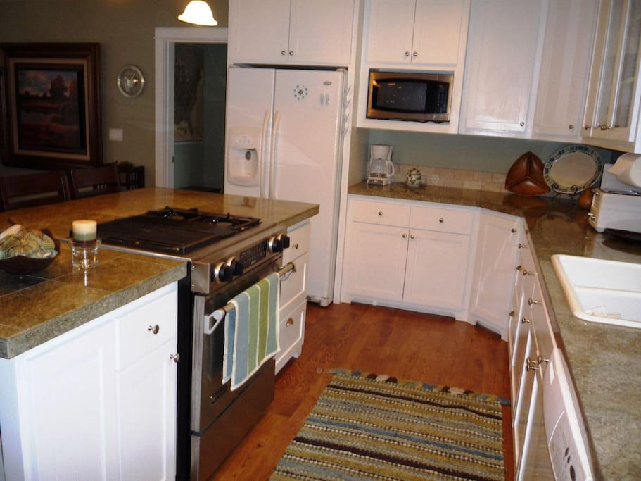 Nice gas stove and lots of cooking space...stocked with everything you should need.