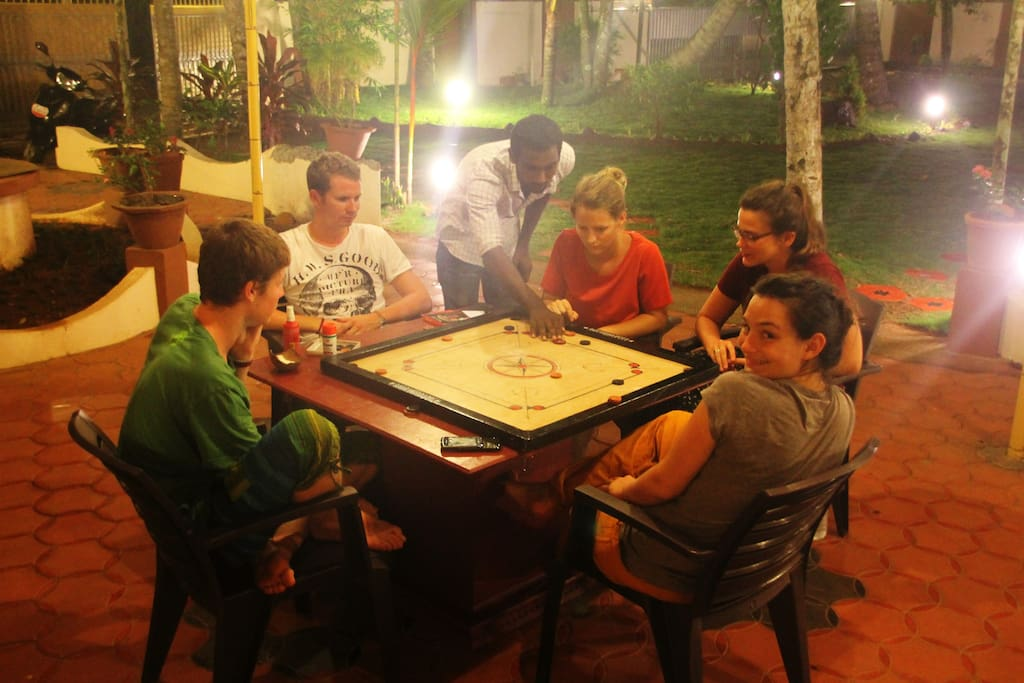 Guests playing carrom in our communal area
