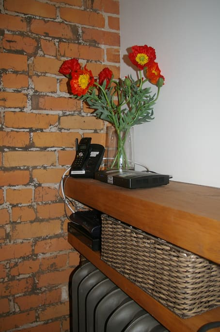 Exposed brick walls, steam radiators and a phone with locally calling