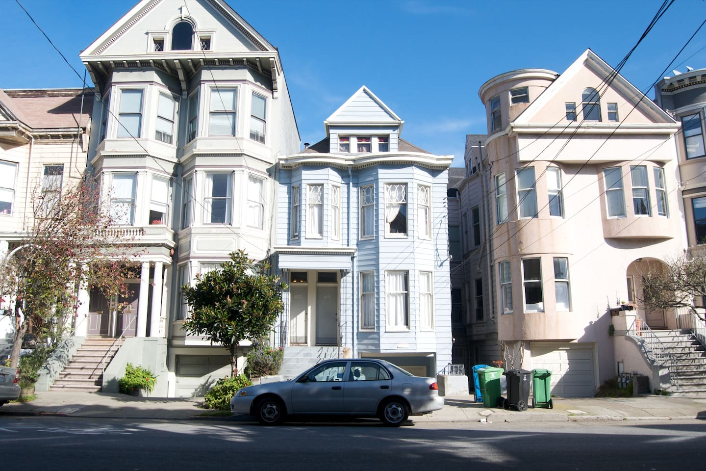 Taking center stage is this classic 1907 San Francisco Victorian building (center, blue house).