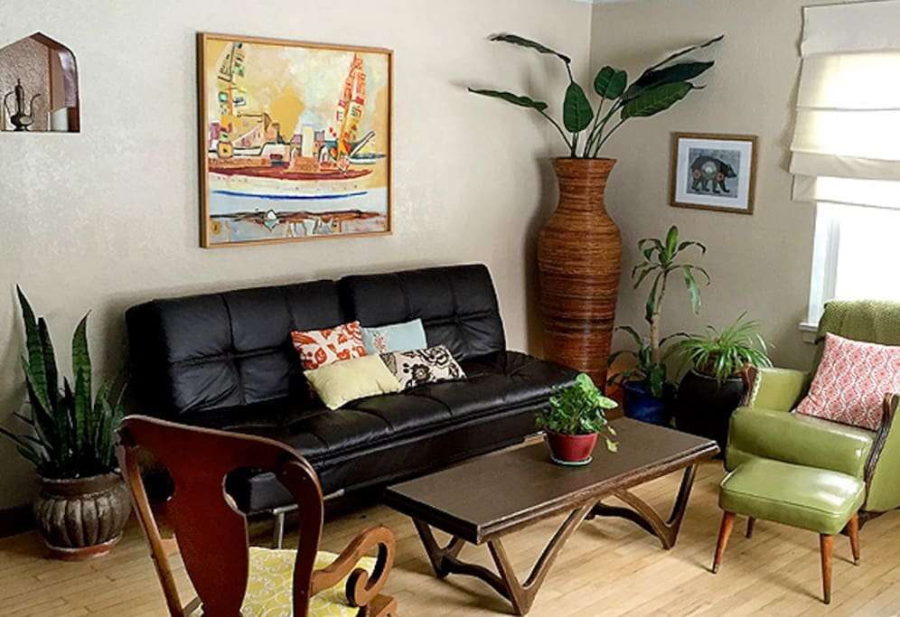 Living room with great natural light and futon couch.