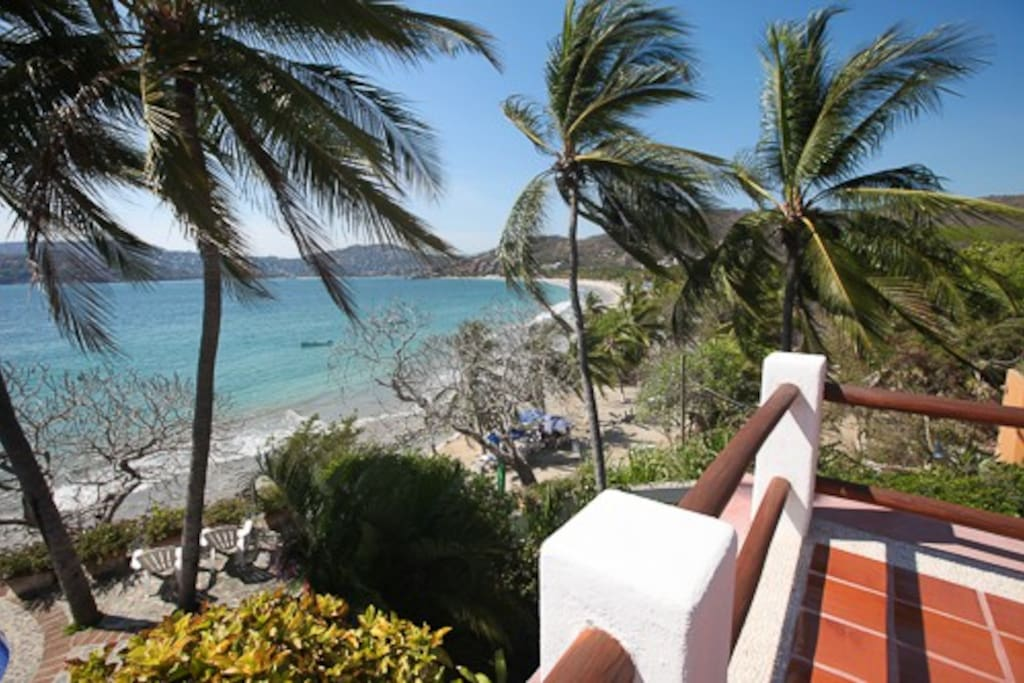 We're this close to the beach:  the corner of our upper terrace and La Ropa beach, immediately below.