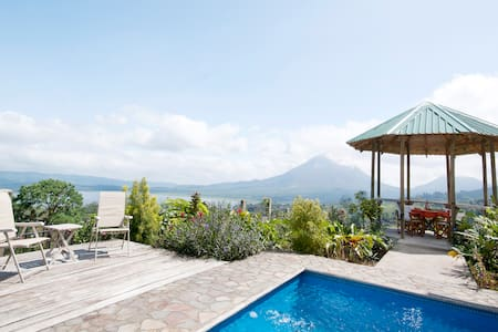 "Our home is one of the top-rated in Costa Rica.  Guests enjoy splendid views and privacy yet are close to many attractions and amenities.  Experience an ""authentic"" Tico experience in a picturesque and friendly village just 7 km from Arenal Volcano."