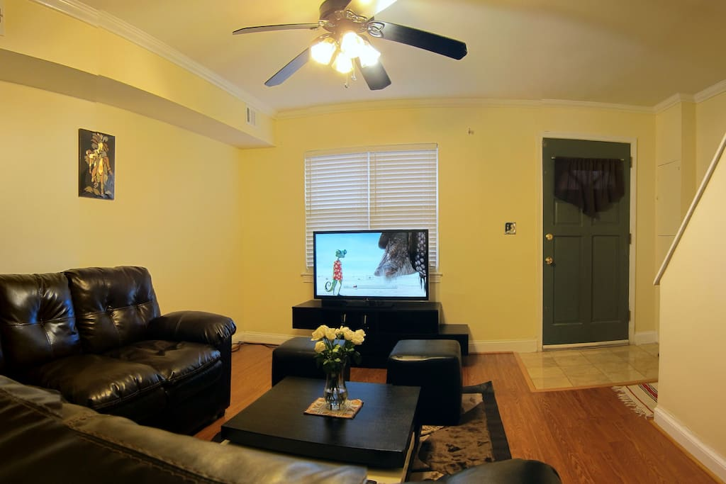 The living room featuring brand new 47'' Panasonic TV