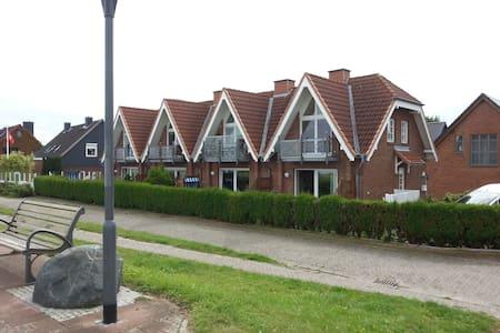 Ferienwohnung direkt an Deich und Strand-Meerblick - Apartamento
