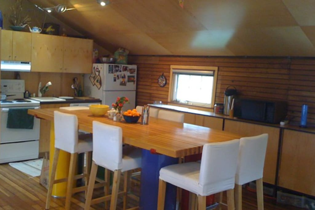 Full kitchen with custom table, upcycled from bowling alley wood