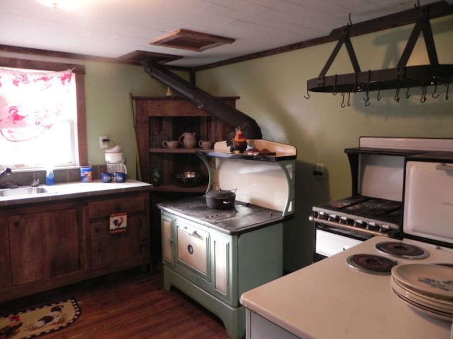 Kitchen with operational antique stoves