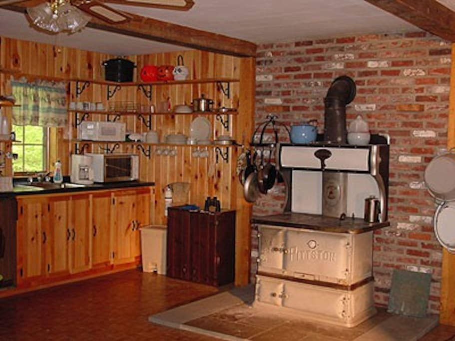 Kitchen area of cabin.  The wood fires cook stove works and is heat source.
