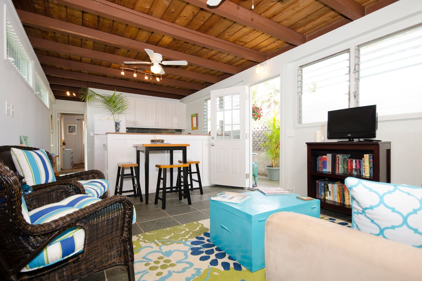 bright and airy cottage with a full kitchen and comfortable seating.