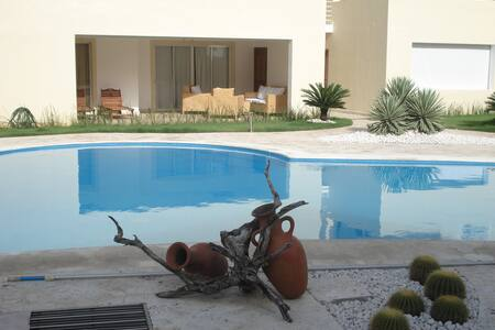 Very nice, comfortably and favorable 107sqm apartment directly in front of the large pool to relax 100% and only few steps to one of the world's most beautiful private beaches. A good price-performance ratio.