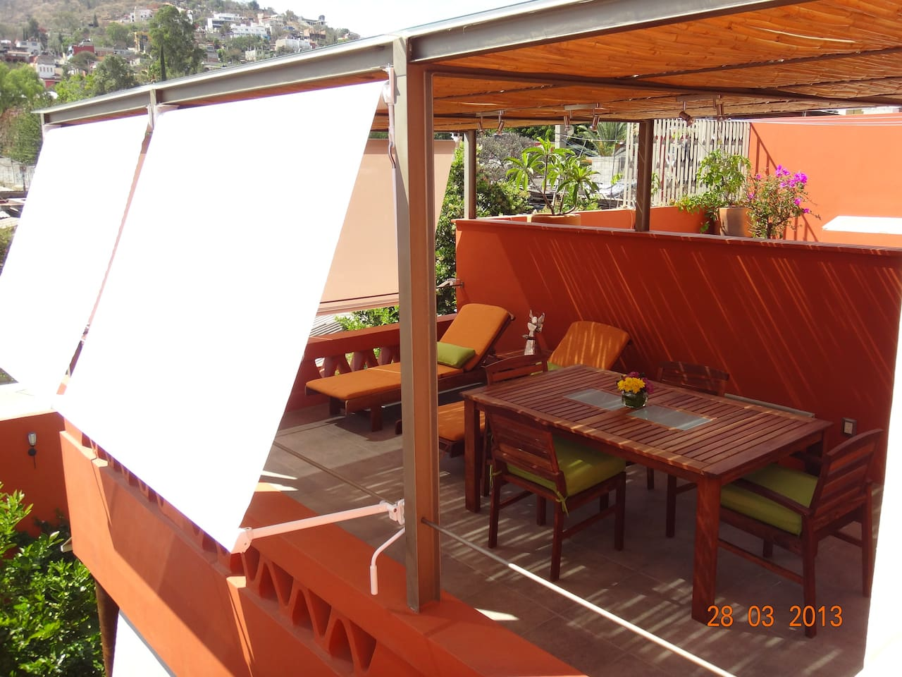 Covered terrace with sun blinds