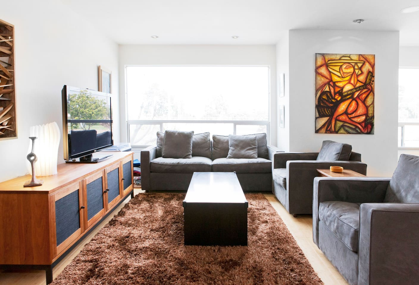 Our Chestnut St condo is full of light, original art, and comfy modern furniture.
