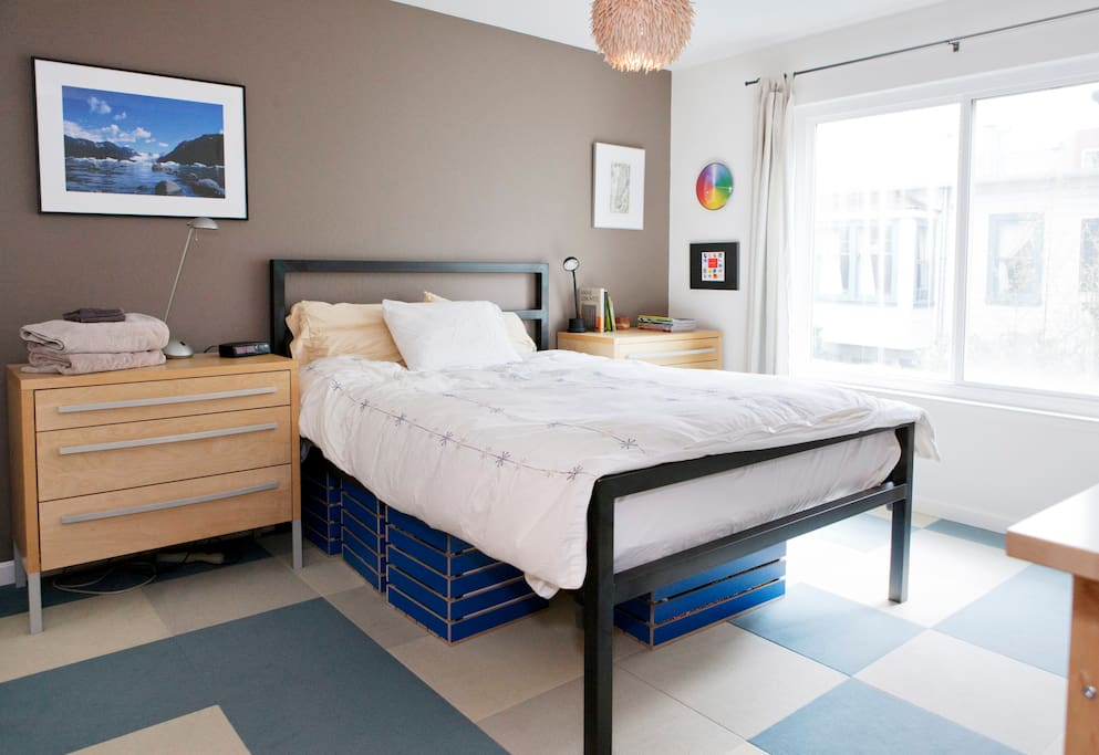 Master bedroom is bright and cheery with a large window that overlooks the courtyard.