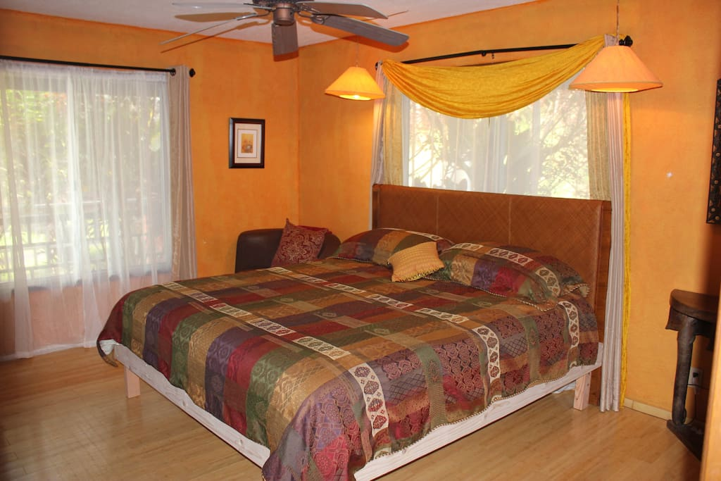Master Bedroom (Passion Flower) w/ King Bed and Private Bath.