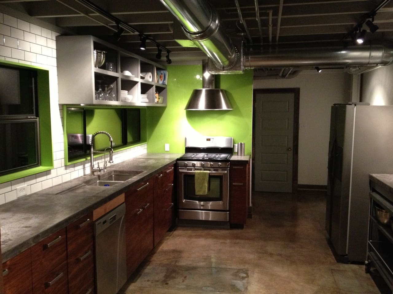 All New Chef's Kitchen with Concrete Counters and Stainless Rolling Island
