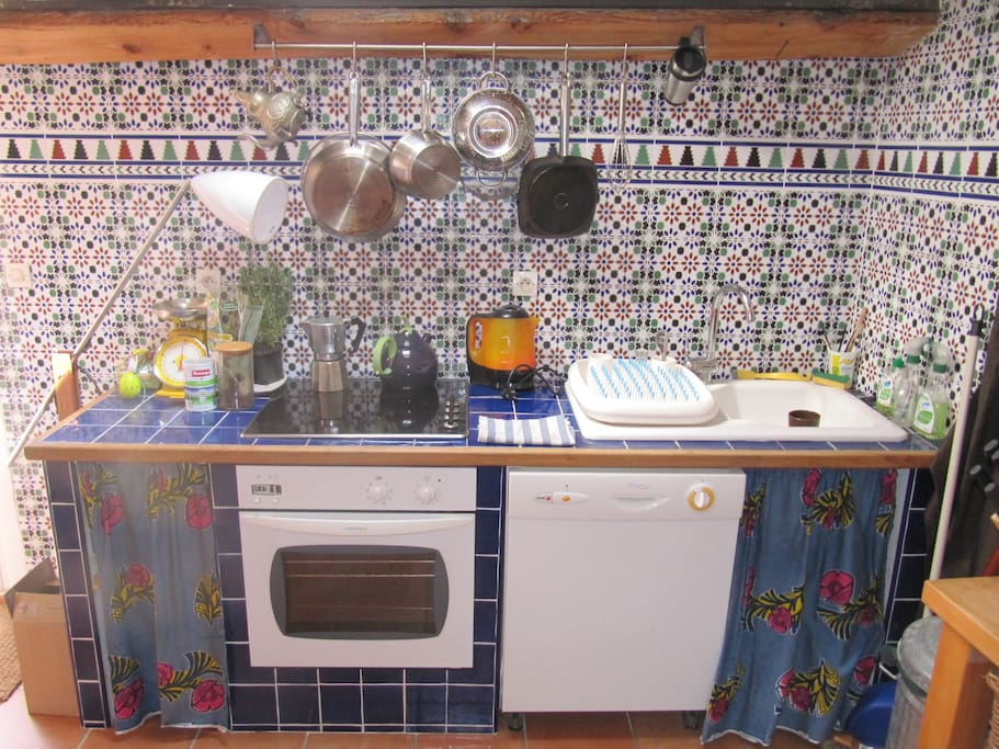 The work-top with electric plates, oven and dishwasher