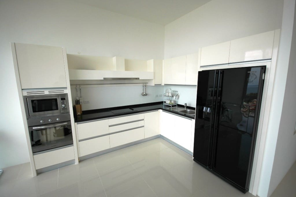 Full size kitchen with a huge fridge/freezer, oven and micro wave