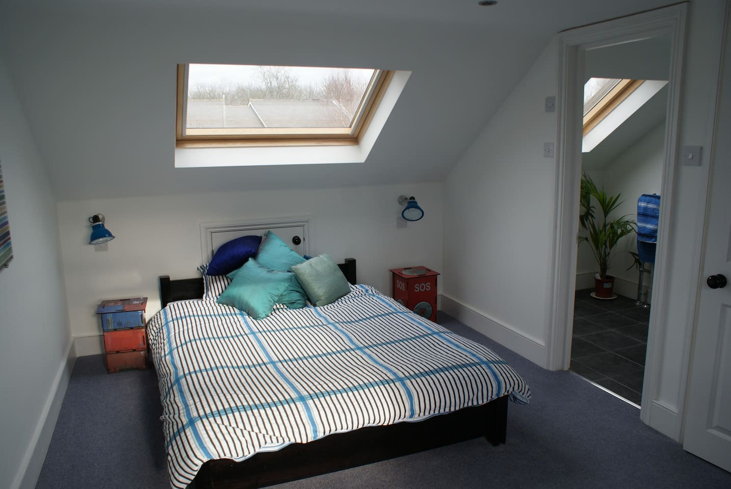 Spacious double bedroom with view of ensuite bathroom