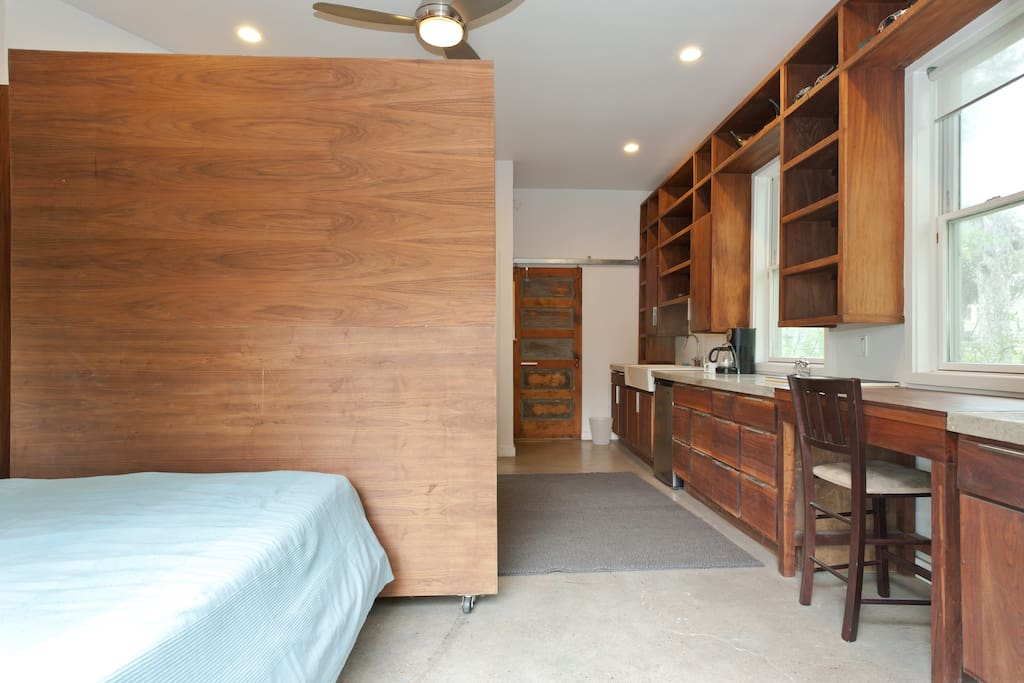 Putting the Murphy bed down creates two different regions in the cottage for extra privacy.