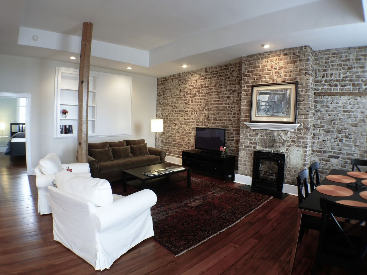Living and dining area with original exposed brick.