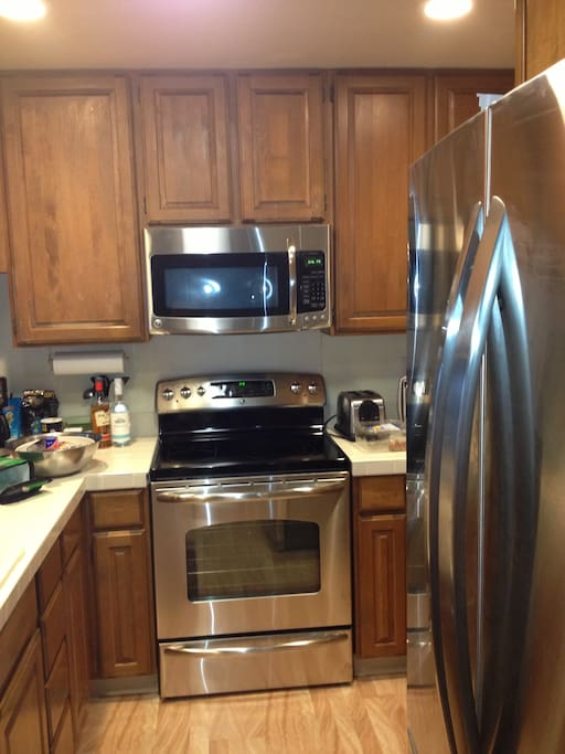 Upgraded stainless kitchen appliances make this space sparkle!