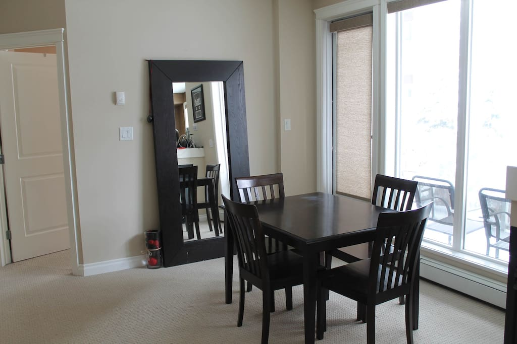 Dining room table and access to sunny balcony