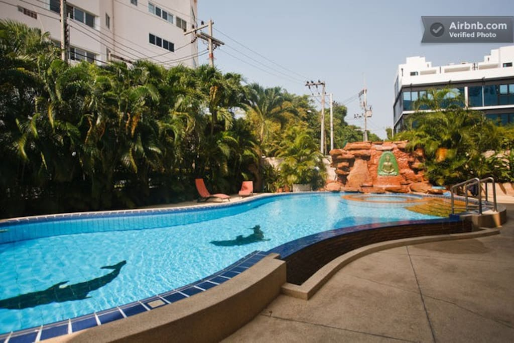 Communal swimming pool inc waterfall feature.