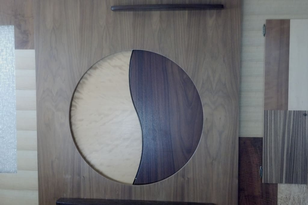 Beautiful art doors meet in the middle as a yin/yang design in the wheelchair friendly bedroom.