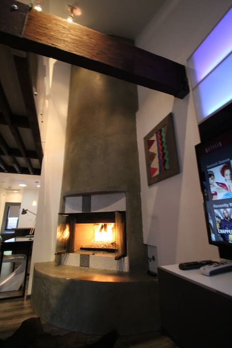 16 feet (4.88 meter) high gas fireplace makes the room cozy and grand at the same time.